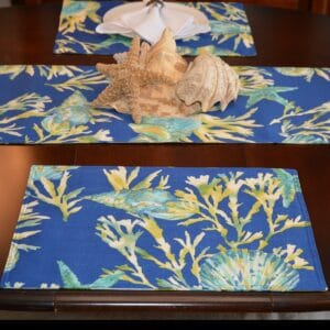 Sweet Pea Linens - Blue Seashell & Tropical Leaf Outdoor Fabric Rectangle Placemats - Set of Four plus Center Round-Charger (SKU#: RS5-1002-A13) - Table Setting