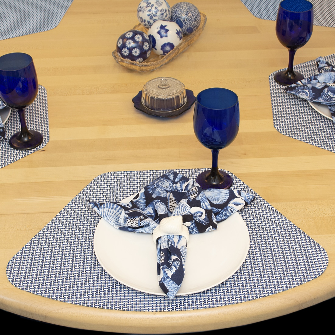 Sweet Pea Linens - Blue Seashell Rolled Hem Cloth Napkin (SKU#: R-1010-F18) - Table Setting