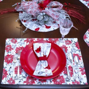 Sweet Pea Linens - Red Christmas Poinsettia & Cardinal Rectangle Placemats - Set of Four plus Center Round-Charger (SKU#: RS5-1002-X3) - Table Setting